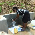 The Water Project: Ikonyero Community, Amkongo Spring -  Enjoying The Spring Water
