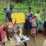 The Water Project: Shihungu Community, Shihungu Spring -  A Wave From The Little Ones