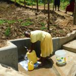 The Water Project: Ikonyero Community, Amkongo Spring -  Happy Fetching Water