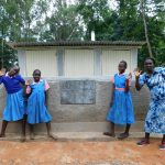 The Water Project: Kimangeti Primary School -  Happy Faces In Front Of The Girls Latrines