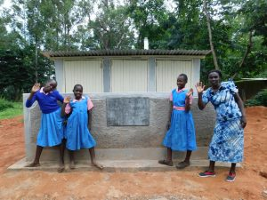 The Water Project:  Happy Faces In Front Of The Girls Latrines