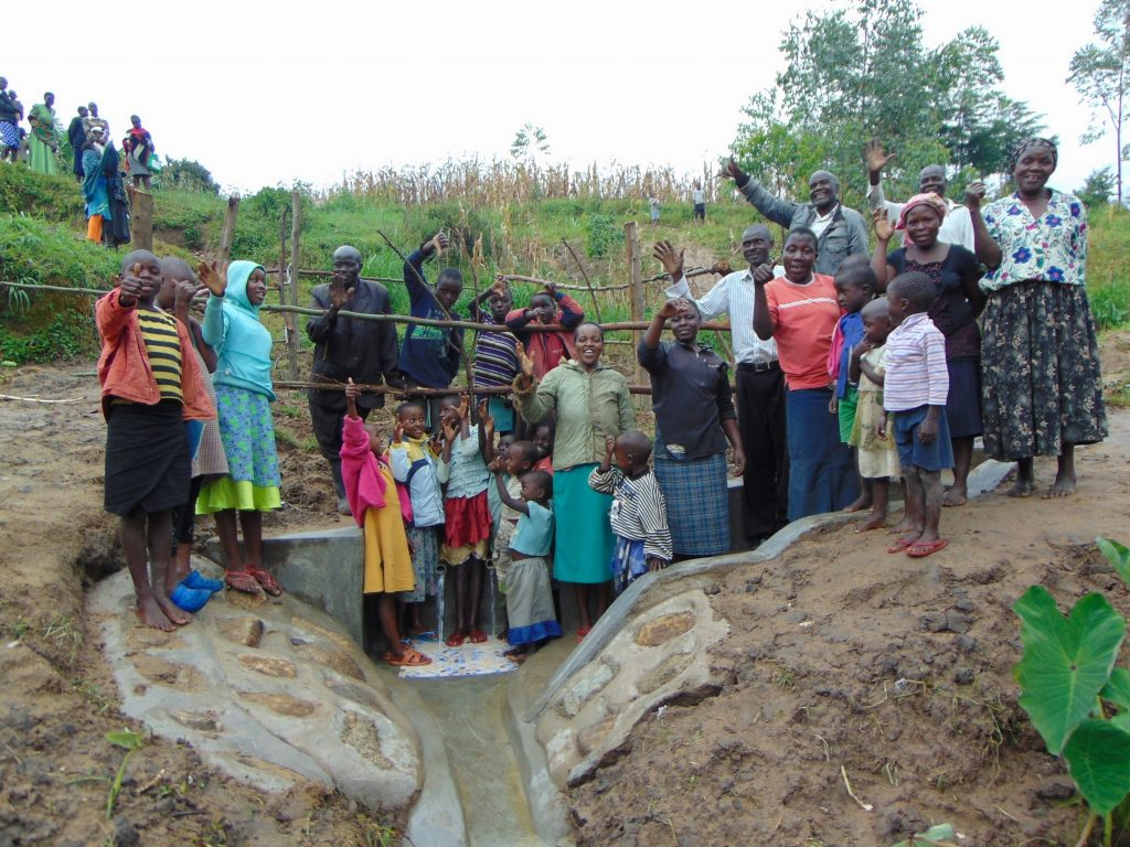 The Water Project : 34-kenya19151-community-celebrating-the-new-spring
