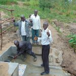 The Water Project: Sasala Community, Kasit Spring -  Smiles And Thumbs Up For Clean Water