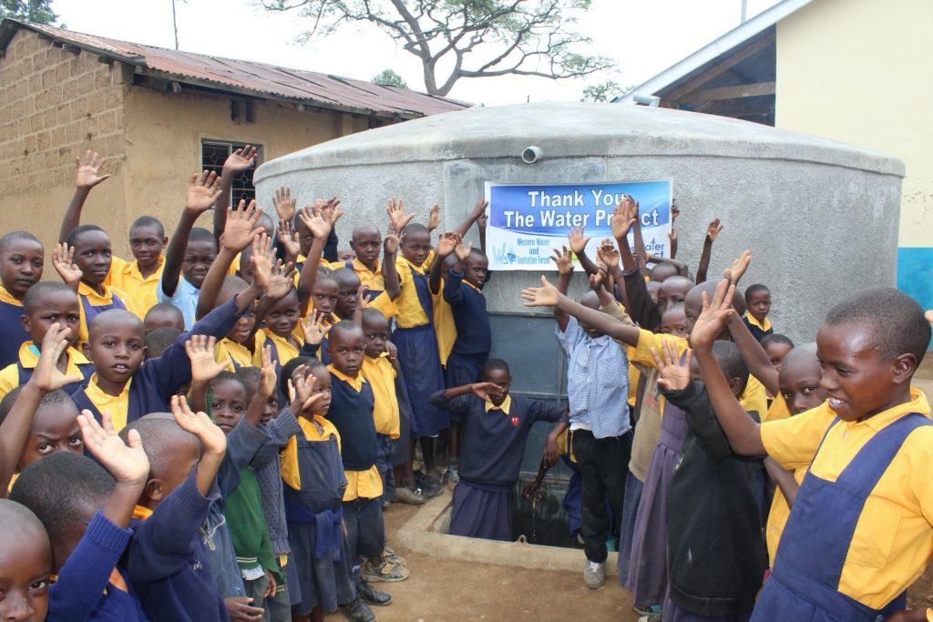 The Water Project : 37-kenya19061-celebrating-the-rain-tank-2
