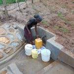 The Water Project: Shihungu Community, Shihungu Spring -  Happy Fetching Water