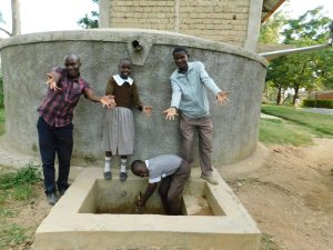 The Water Project:  Field Officer Victor Musemi With Students And Mr Chisikwa At Rain Tank
