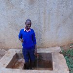 The Water Project: Bumuyange Primary School -  Norman At The Rain Tanks Tap