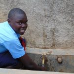 The Water Project: Gidagadi Secondary School -  Student At The Rain Tanks Tap