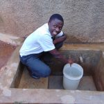The Water Project: Precious School Kapsambo Secondary -  Student Fetching Water