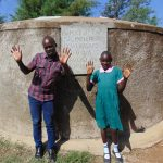 The Water Project: Mavusi Primary School -  Victor And Gertrude At The Rain Tank