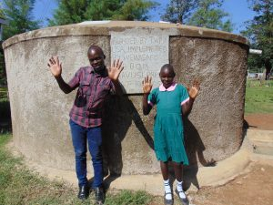 The Water Project:  Victor And Gertrude At The Rain Tank