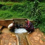 The Water Project: Shirakala Community, Ambani Spring -  Field Officer Jaclyne With John Lihavo