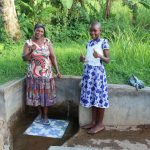 The Water Project: Mukhangu Community, Okumu Spring -  Felistus And Lucy Give Thumbs Up For Clean Water