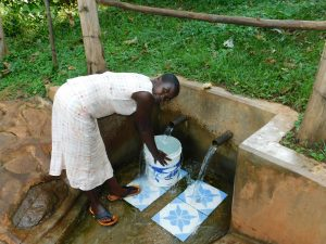 The Water Project:  Woman Fetches Water