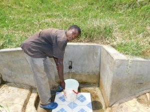 The Water Project:  Dennis Ommollo Fetches Water