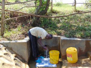The Water Project:  Khanal Enjoying The Spring Water