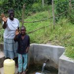 The Water Project: Ewamakhumbi Community, Yanga Spring -  Hellen And Robinson Wave From The Spring