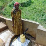 The Water Project: Isembe Community, Amwayi Spring -  Josephine Ambani Fetches Water