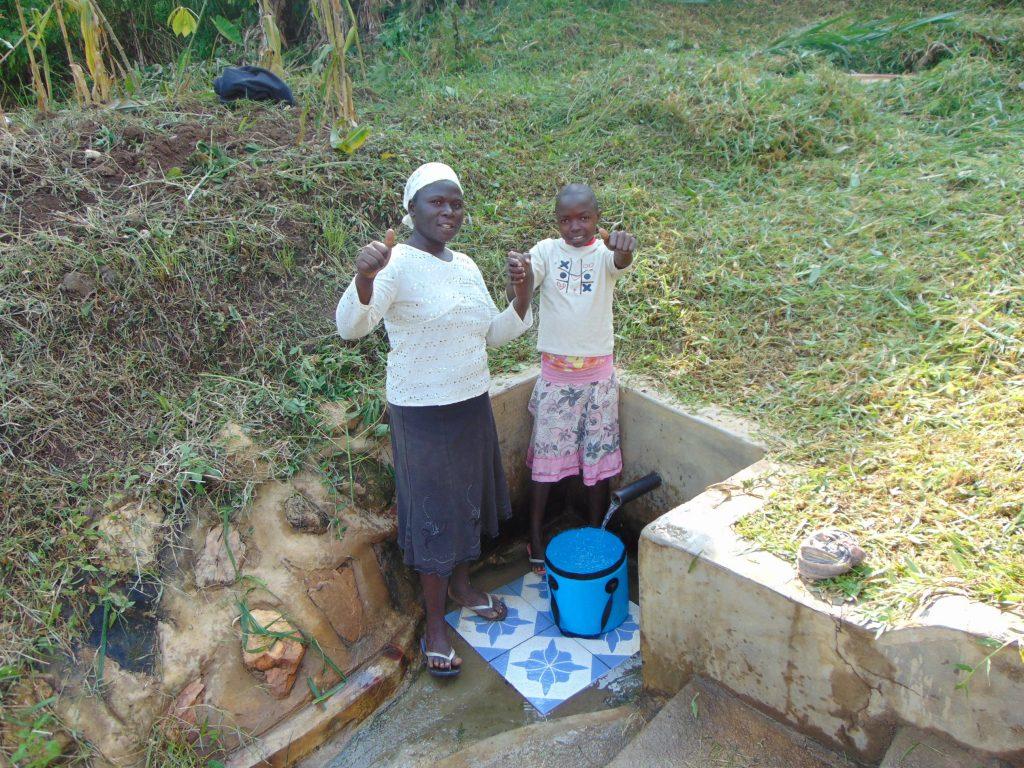 The Water Project : 4-kenya18154-doris-and-melvin-at-the-spring