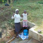 The Water Project: Ematetie Community, Weku Spring -  Doris And Melvin At The Spring