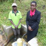The Water Project: Ematetie Community, Chibusia Spring -  John Weku With Field Officer Rose Serete