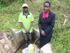 The Water Project:  John Weku With Field Officer Rose Serete