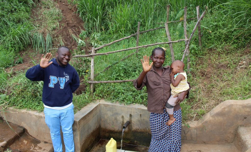 The Water Project : 4-kenya18162-field-officer-allan-amadaro-with-judith