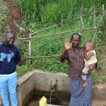 The Water Project: Shitoto Community, Mashirobe Spring -  Field Officer Allan Amadaro With Judith