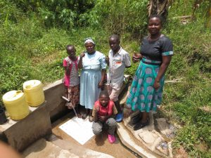 The Water Project:  Field Officer Betty With Spring Users