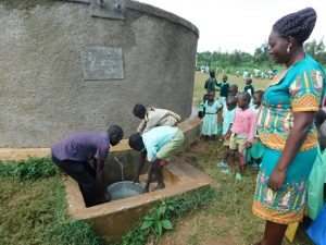 The Water Project:  Sanitation Patron Supervises Water Collection For Kitchen Use