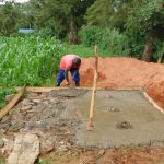 The Water Project: Kimangeti Primary School -  Pouring The Cement For Latrine Foundation