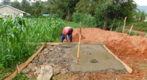 The Water Project:  Pouring The Cement For Latrine Foundation