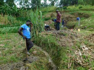 The Water Project:  Digging Drainage For Spring Water