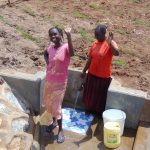 The Water Project: Shihungu Community, Shihungu Spring -  Smiles And Waves From The Spring