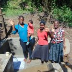 The Water Project: Buyangu Community, Osundwa Spring -  Field Officer Christine Masinde With Community Members