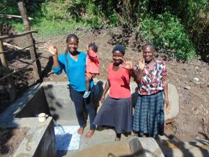 The Water Project:  Field Officer Christine Masinde With Community Members