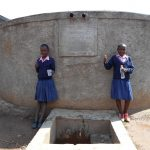 The Water Project: Friends Kaimosi Demonstration Primary School -  Girls At The Rain Tank