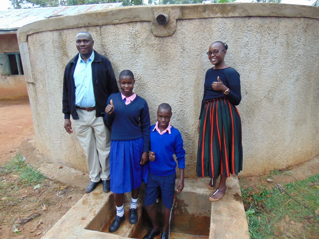 The Water Project : 5-kenya18067-mr-shibira-irene-norman-and-field-officer-joan-were