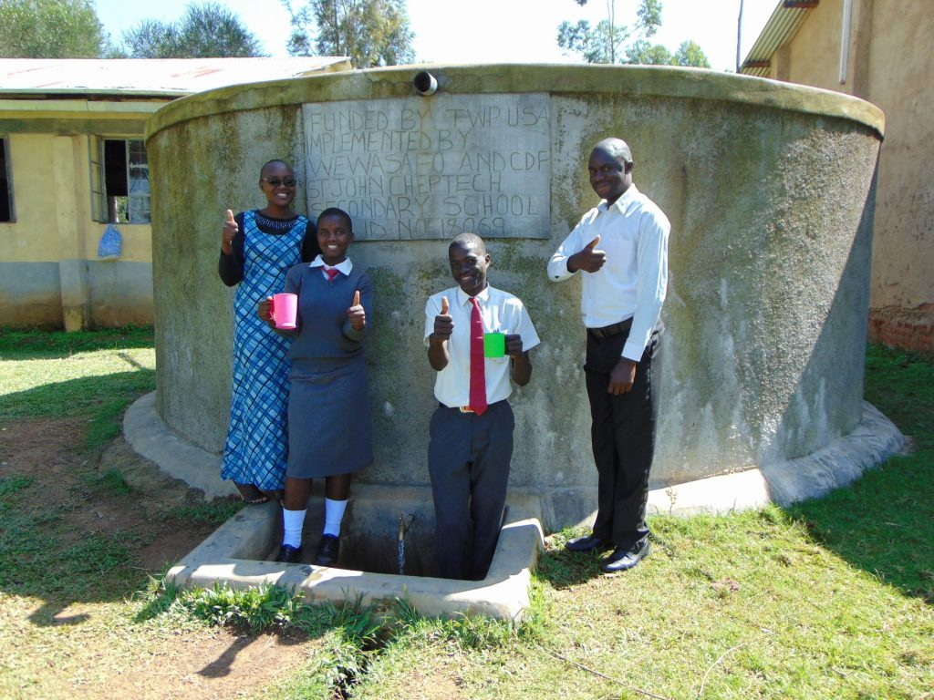 The Water Project : 5-kenya18069-field-officer-joan-were-with-derrick-mr-idache-and-another-student
