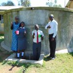 The Water Project: St. John Cheptech Secondary School -  Field Officer Joan Were With Derrick Mr Idache And Another Student