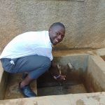 The Water Project: Precious School Kapsambo Secondary -  Student At The Rain Tanks Tap