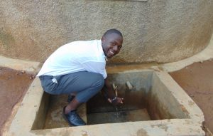 The Water Project:  Student At The Rain Tanks Tap