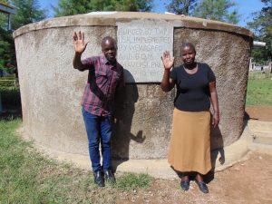 The Water Project:  Victor And Mrs Nkumu At The Rain Tank