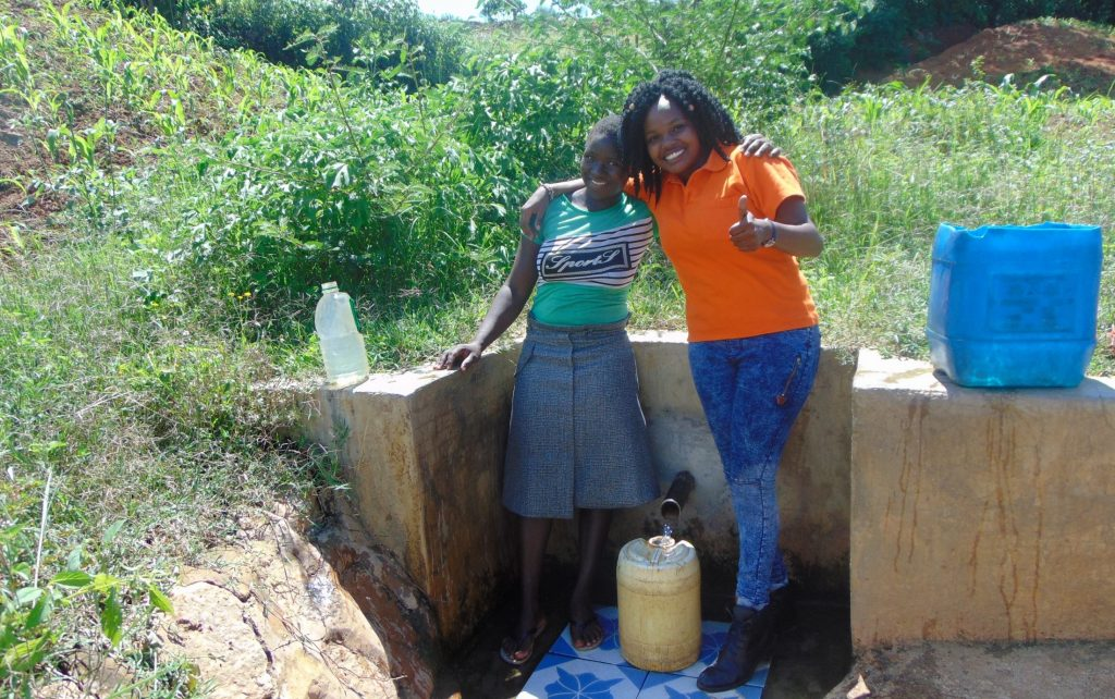 The Water Project : 5-kenya18106-field-officer-georgina-with-community-member