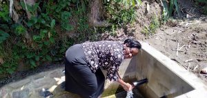 The Water Project:  Karen Enjoying The Spring Water