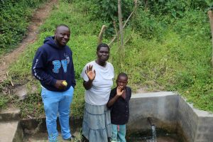 The Water Project:  Field Officer Allan Amadaro With Hellen And Robinson