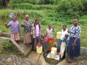 The Water Project:  Happy Spring Users With Field Officer Betty
