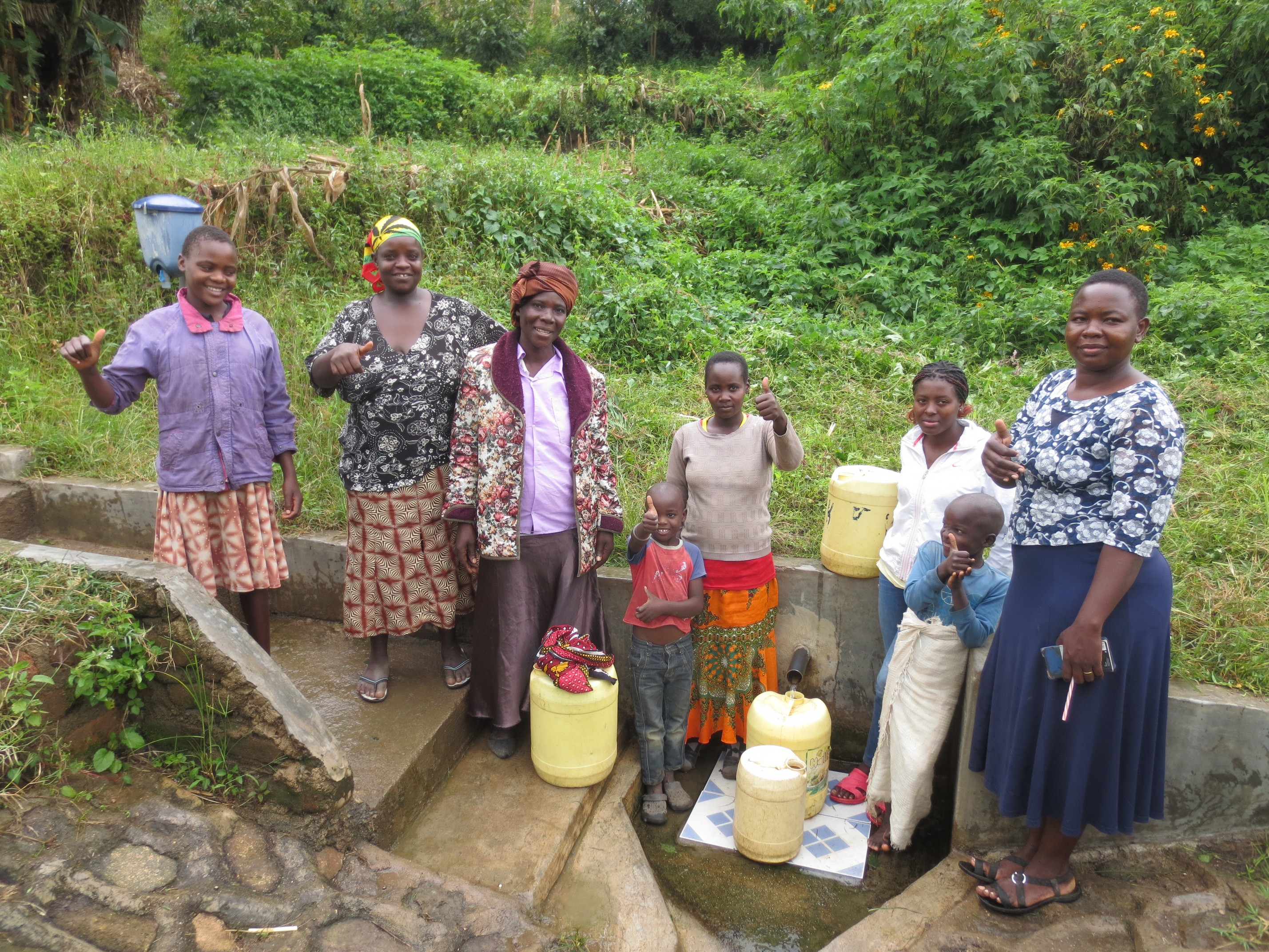 The Water Project : 5-kenya18145-happy-spring-users-with-field-officer-betty
