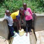 The Water Project: Ivinzo Commuity, Mushianda Spring -  Rose With Other Kids Fetching Water