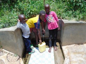 The Water Project:  Rose With Other Kids Fetching Water